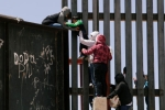 Video Clip Shows Punjabi Women, Children Crossing Border Fence into U.S.
